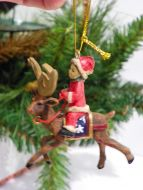 Child kid on reindeer decoration miniature vintage collectible elegant ornamen